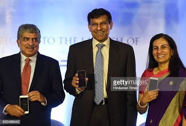 Reserve Bank of India Governor Raghuram Rajan Nandan Nilekani and Managing Director and Chief Executive Officer of ICICI Bank Chanda Kochhar during...