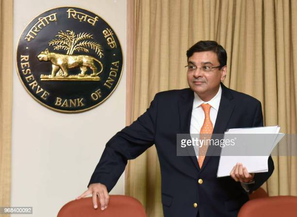 Reserve Bank of India Governor Urjit Patel arrives for a news conference at the bank's head office in Mumbai on June 6 2018 India's central bank...