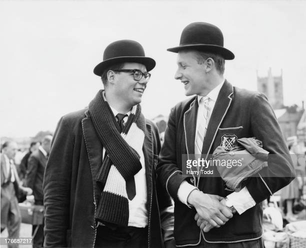 Reserve Dutch rowers from the 'Nereus Rowing Club' of Amsterdam Tom Dokkum and Wilhelm Rynders watch the action at the opening day of the Henley...