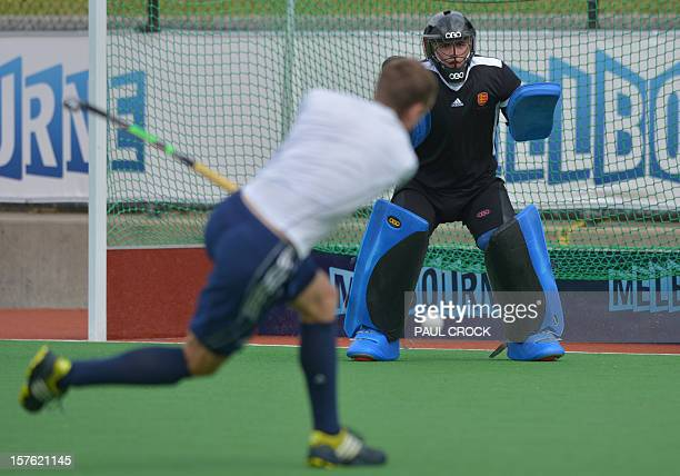 Reserve goal keeper Patrick Smith of England eyes the ball from Dan Fox at a practice session at the Men's Hockey Champions Trophy in Melbourne on...