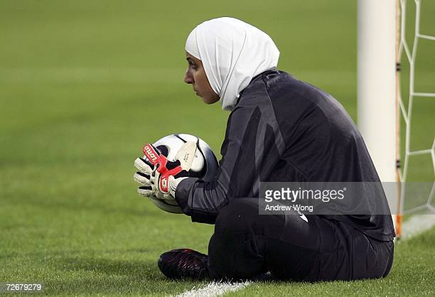 Reserve goalkeeper Misda Ramounieh of Jordan sits on the pitch during warmups during the 15th Asian Games Doha 2006 Women's Preliminary Round Group A...