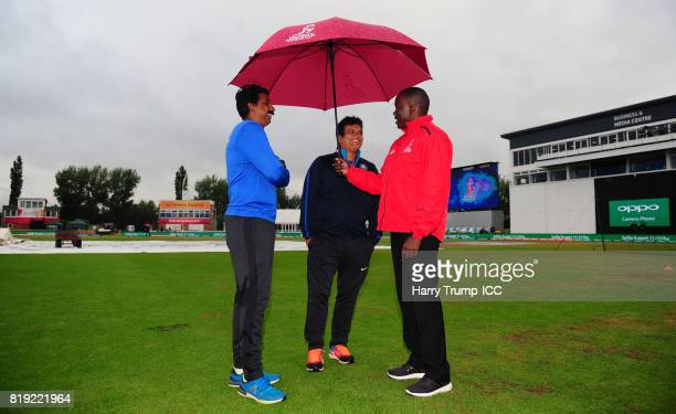 Reserve Umpire Langton Rusere chats with Tushar Arothe Coach of India during the ICC Women's World Cup 2017 match between Australia and India at The...