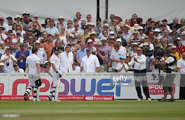 Reserve Umpire Tim Robinson tells Ian Bell and Eoin Morgan of England not to leave the field after Ian Bell is controversially run out during the...