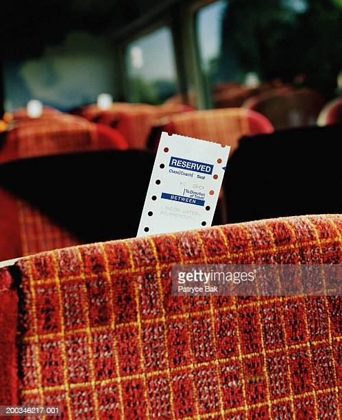 Reserved seat ticket in train car, close-up