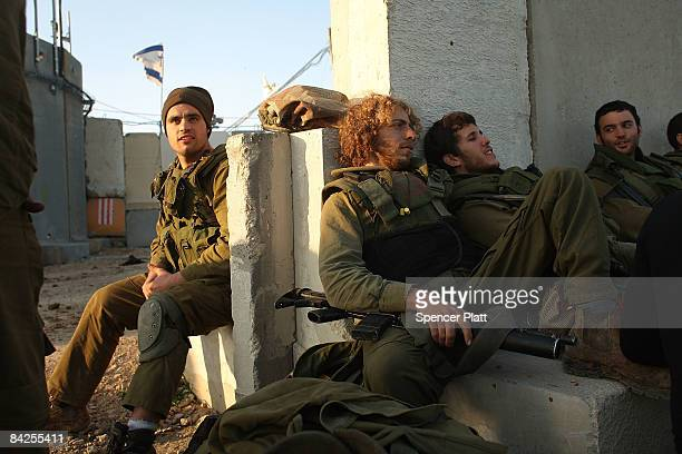 Reservist Israeli soldiers who just came out of Gaza relax on January 12 2009 along the GazaIsraeli border Peace talks stall as fighting continues...