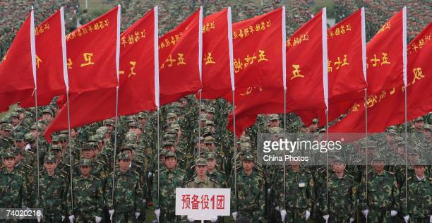 Reservists of the Chinese People's Liberation Army attend a ceremony at a stadium on April 28 2007 in Nanjing of Jiangsu Province China China's...
