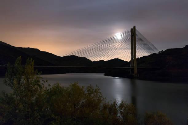 Reservoir bridge of Barrios de Luna, Len. With full moon.