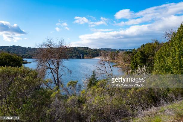 Reservoir with dam visible on a sunny day at the Lafayette Reservoir Recreation Area, an East Bay Regional Park, Lafayette, California, February 26,...