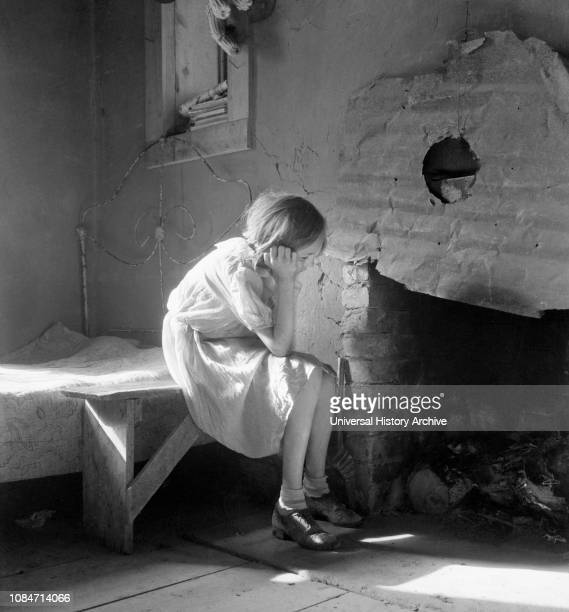 Resettled Farm Child from Taos Junction to Bosque Farms Project, Portrait Sitting near Fireplace, Mills, New Mexico, USA, Dorothea Lange, Farm...