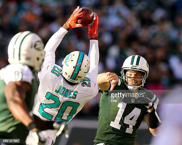 Reshad Jones of the Miami Dolphins bats down a pass by Ryan Fitzpatrick of the New York Jets on November 29 2015 at MetLife Stadium in East...