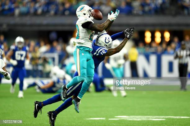 Reshad Jones of the Miami Dolphins breaks up a pass intended for Dontrelle Inman of the Indianapolis Colts in the second quarter at Lucas Oil Stadium...