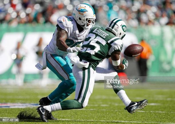 Reshad Jones of the Miami Dolphins defends a pass attempts to Elijah McGuire of the New York Jets during the second half of an NFL game at MetLife...