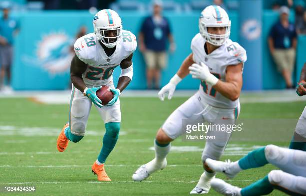 Reshad Jones of the Miami Dolphins intercepts the ball during the game against the Tennessee Titans at Hard Rock Stadium on September 9 2018 in Miami...
