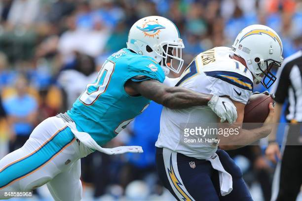 Reshad Jones of the Miami Dolphins sacks Philip Rivers of the Los Angeles Chargers during the game at the StubHub Center on September 17 2017 in...