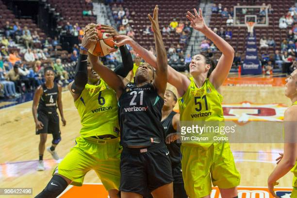 Reshanda Gray of the New York Liberty challenges for a rebound with Kayla Thornton of the Dallas Wings and Natalie Butler of the Dallas Wings during...
