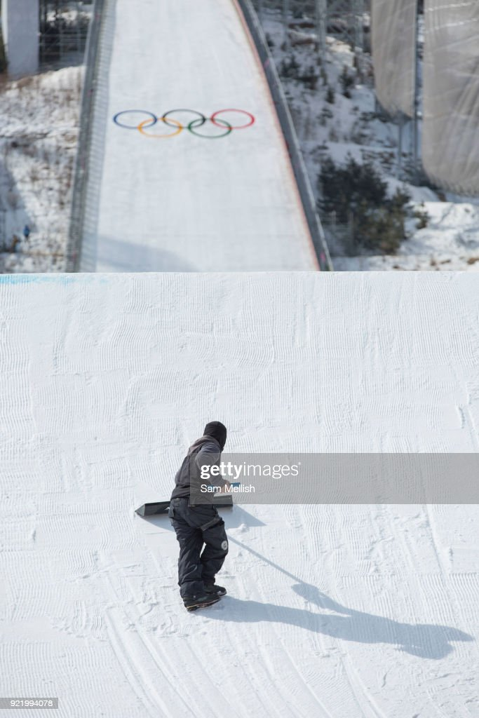 Reshaping the kicker during the men's snowboard big air qualification at the Pyeongchang 2018 Winter Olympics on February 21st 2018, at the Alpensia Ski Jumping Centre in Pyeongchang-gun, South Korea