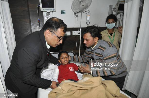 Reshu suffered fracture in the hand as the boundary wall of a private school in Salarpur village collapsed on December 17 2018 in Noida India Two...