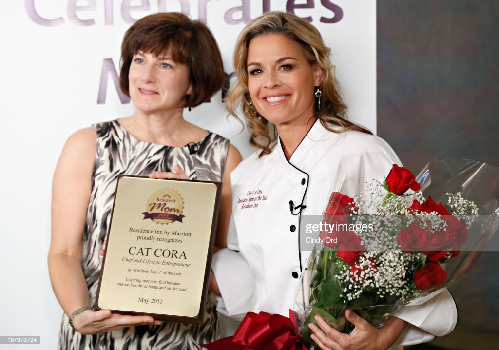 Residence Inn by Marriott VP and Global Brand Manager, Diane Mayer presents the Residence Inn by Marriott 2013 Resident Mom of the Year award to chef and lifestyle entrepreneur Cat Cora (R) at the 2013 Resident Mom of the Year event at Residence Inn by Marriott on May 3, 2013 in New York City.