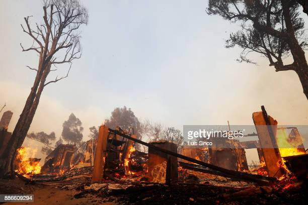 A residence is reduced to embers after being burned by the Creek Fire near the intersection of Johanna Avenue and McBroom Street in Shadow Hills on...