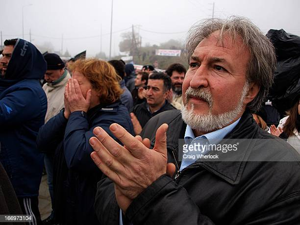 Residence of the Halkidiki region of northern Greece gather to listen to anti-mine protesters. Older man clapping, woman crying.