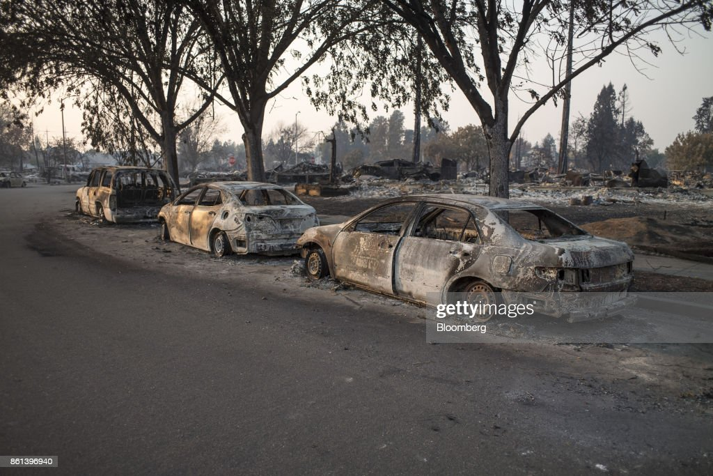 Residences and vehicles burned by wildfires sit in Santa Rosa, California, U.S., on Friday, Oct. 13, 2017. Wildfires that tore through northern California's iconic wine-growing regions have prompted evacuations of more than 20,000 people, killed 11 and damaged some of the most valuable vineyards and wineries in the U.S. About 1,500 commercial, residential and industrial structures were burned, and damage assessment teams have started accounting for the destruction. Photographer: David Paul Morris/Bloomberg via Getty Images