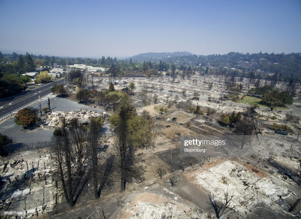 Residences burned by wildfires are seen in this aerial photograph taken above Santa Rosa, California, U.S., on Thursday, Oct. 12, 2017. Wildfires that tore through northern California's iconic wine-growing regions have prompted evacuations of more than 20,000 people, killed 11 and damaged some of the most valuable vineyards and wineries in the U.S. About 1,500 commercial, residential and industrial structures were burned, and damage assessment teams have started accounting for the destruction. Photographer: Chip Chipman/Bloomberg via Getty Images