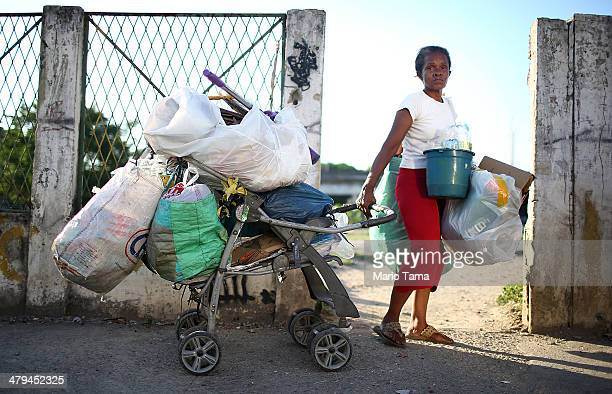 Resident and refuse picker or catadora Dona Lucinda poses while working in the unpacified Complexo da Mare slum complex one of the largest favela...