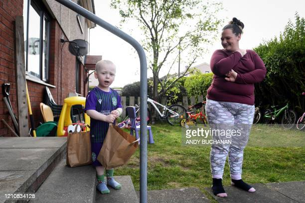 Resident Becky Foster poses with her son Christopher Bain after Social Bite social enterprise volunteer Russell Bowers delivered free packed lunches...