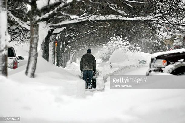 Resident begins to dig out after a five mile wide band of lake-effect snow dumped more than two feet of snow and closed a 16-mile stretch of the New...