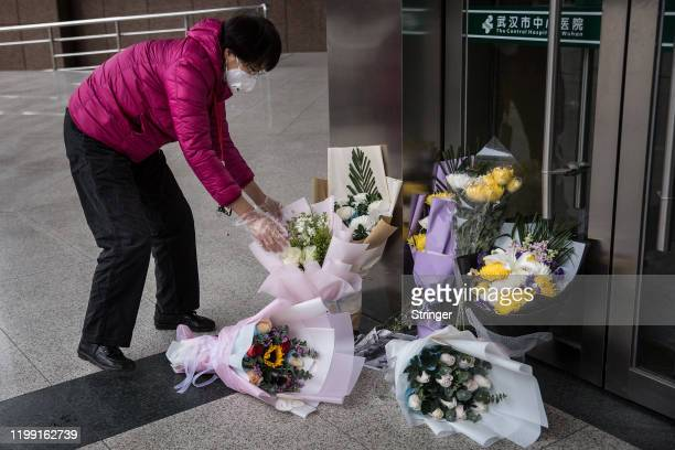 A resident bring bouquets of flowers to pay tribute to Dr Li Wenliang at Li's hospital on February 072020 in WuhanHubei provinceChina Dr Li regarded...