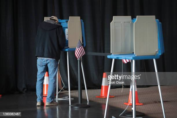 Resident casts a ballot at a polling place set up for early voting on November 01, 2020 in Racine, Wisconsin. Today is the final day for early voting...