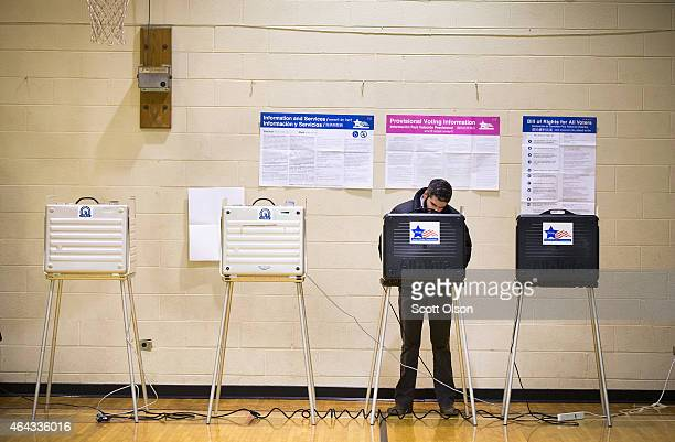 A resident casts his vote at a polling place on election day February 24 2015 in Chicago Illinois Chicago Mayor Rahm Emanuel is hoping to win...