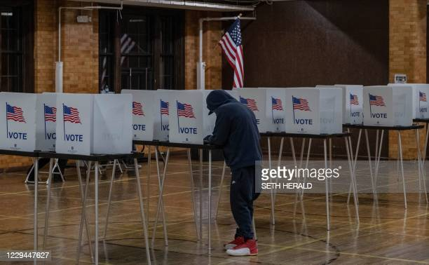 Resident casts his vote on November 3 at Berston Fieldhouse in Flint, Michigan. - The US is voting Tuesday in an election amounting to a referendum...