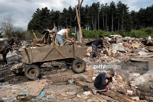 Resident collect materials after their homes were razed in a Roma quarter of Sofia At least 20 homes deemed illegal were destroyed by the local...