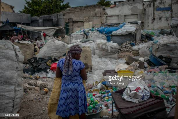 A resident collects plastic bottles in downtown PortAuPrince Haiti on Sunday Jan 28 2018 Billions of aid poured in from donors in the years that...