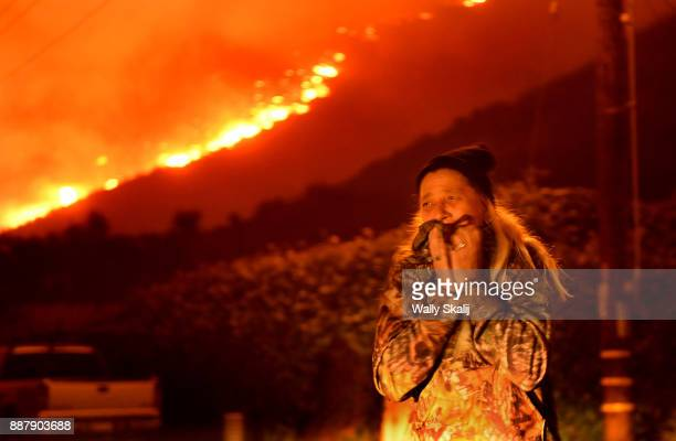 A resident cries as the Thomas Fire approaches the town of La Conchita early Thursday morning