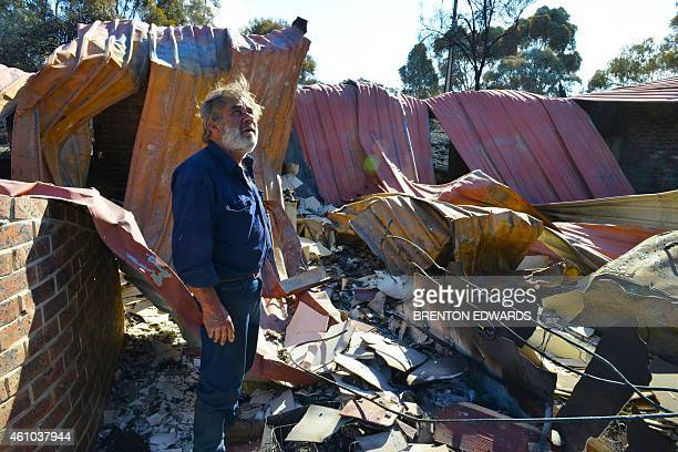 Resident David Miller surveys the remains of his home near Kersbrook that was destroyed by a bushfire in the Adelaide Hills on January 5 2015...