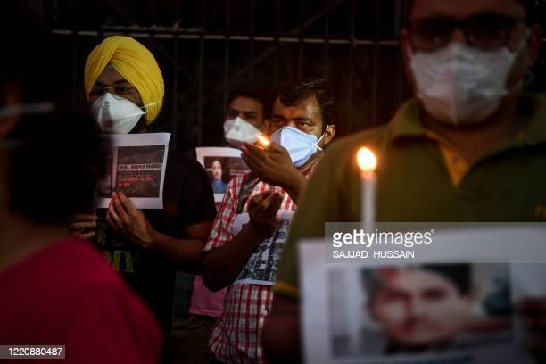 Resident doctors of All India Institute of Medical Science light candles in tribute to the soldiers who lost their lives following a recent clash...