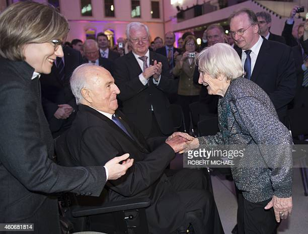 Resident Elfriede Roemer welcomes former German Chancellor Helmut Kohl and his wife Maike KohlRichter prior to the Happily united from German Unity...