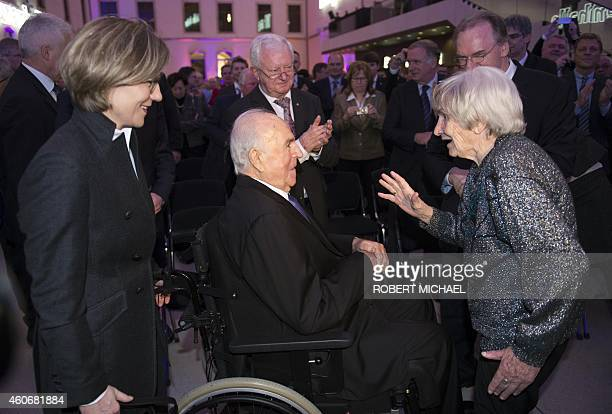 """Resident Elfriede Roemer welcomes former German Chancellor Helmut Kohl and his wife Maike Kohl-Richter prior to the """"Happily united - from German..."""