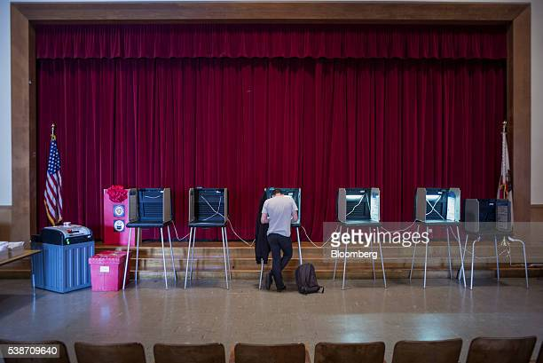 A resident fills in his ballot during the presidential primary election in San Francisco California US on Tuesday June 7 2016 Hillary Clinton secured...