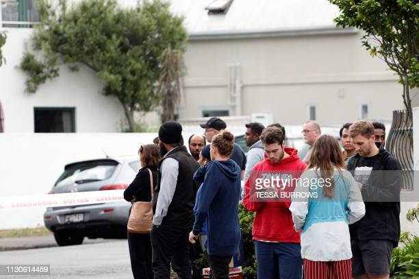 Resident gather at an area near to the location where police have locked down close to the mosques where a shooting incident took place in...