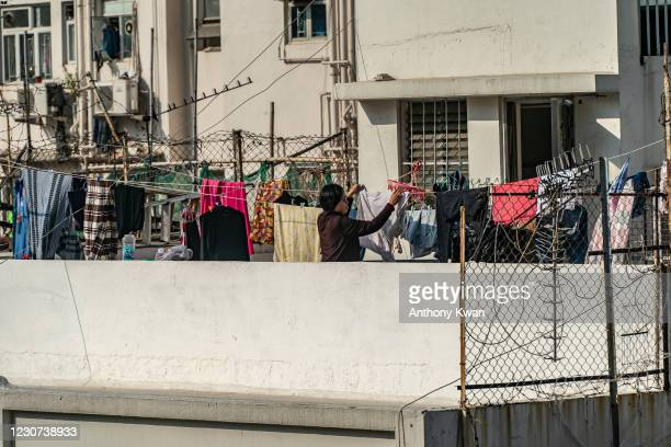 Resident hangs her laundry in a restricted Jordan neighborhood on January 23, 2021 in Hong Kong, China. Hong Kong government locked down tens of...