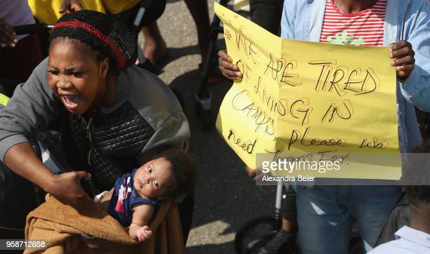 A resident holding her baby shouts during a spontaneous protest at the Bavarian Transit Centre Manching/Ingolstadt for asylumseekers on May 15 2018...