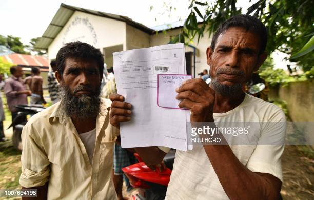 Resident holds documents on his way to check their names on the final list of National Register of Citizens at a NRC Sewa Kendra in Kuranibori...