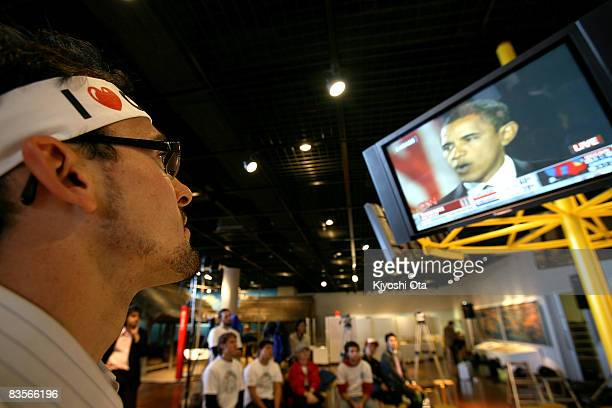 S resident in Japan watches a speech of the Democratic presidential candidate US Sen Barack Obama after his victory in the US presidential election...