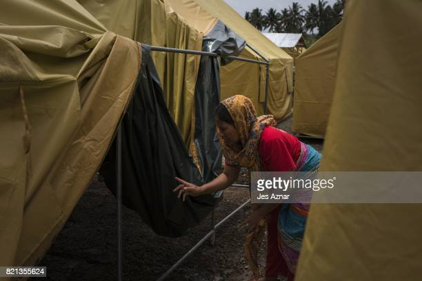 A resident inspecting a tent that will house displaced Marawi residents inside a makeshift evacuation center on July 23 2017 in Pantar Lanao del...