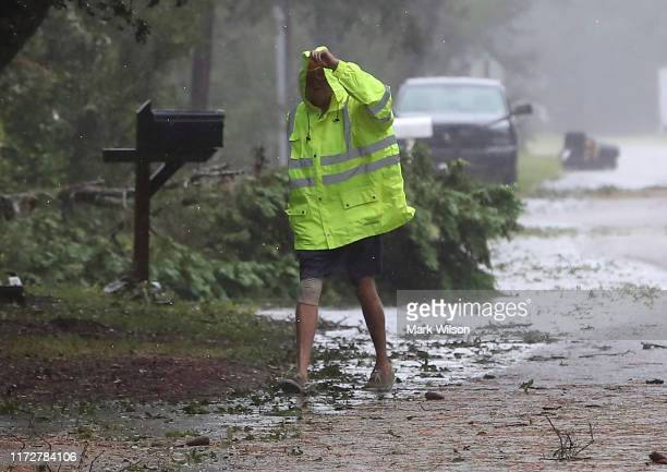 Resident inspects neighborhood damage after Hurricane Dorian hit the area, on September 6, 2019 in Kitty Hawk, North Carolina. Dorian passed...