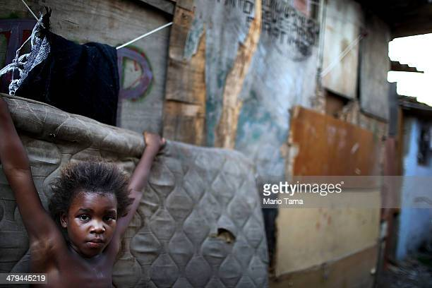 Resident Leiticia stands in an impoverished area in the unpacified Complexo da Mare slum complex one of the largest 'favela' complexes in Rio on...