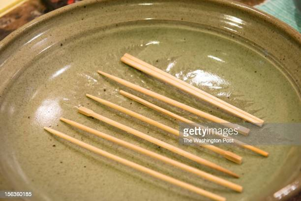 WASHINGTON DC OCTOBER DC resident Lisa Jorgenson puts together a s stuffed vegetarian Hubbard squash chopsticks are used on the serving dish